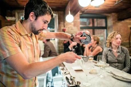 09/21/2012 CAMBRIDGE, MA Bartender Ryan Connelly (cq) pours a cocktail at Belly Wine Bar (cq) in Cambridge. (Aram Boghosian for The Boston Globe)